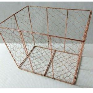 Copper chicken wire framed basket farmhouse bin
